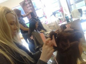hair dressers training staff in hair extensions